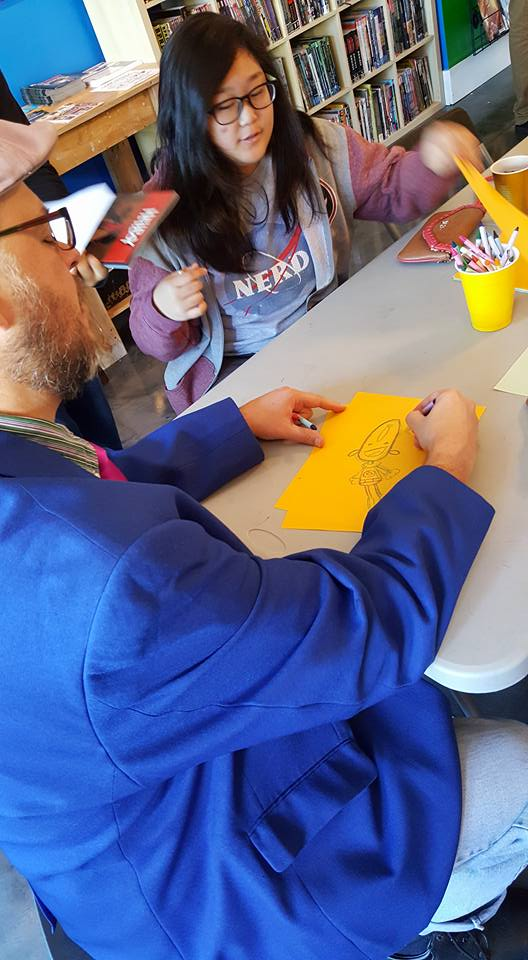 Art Baltazar draws with some kids